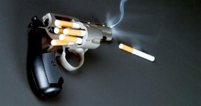 Pistola con cigarros